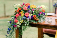 09 Bright blooms with cascading greenery can be seen everywhere, on each table