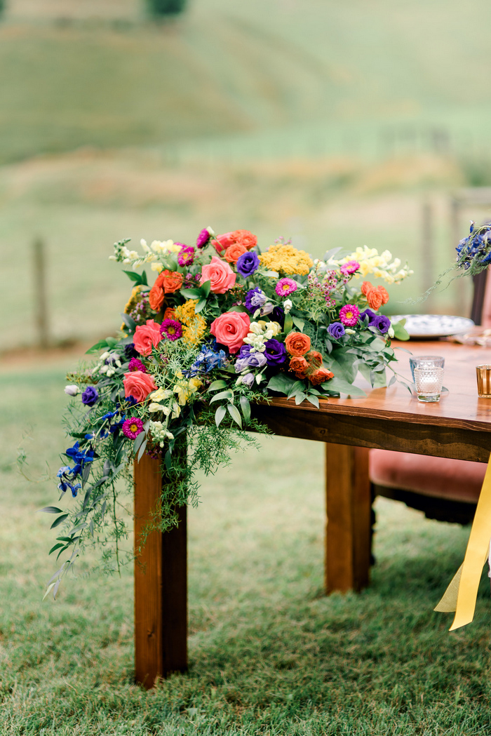 Bright blooms with cascading greenery can be seen everywhere, on each table