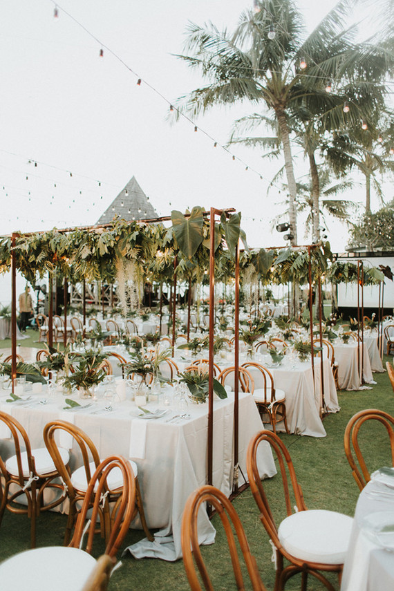 The centerpieces were paired with cascading greenery over the tables to make the venue feel as fresh as possible