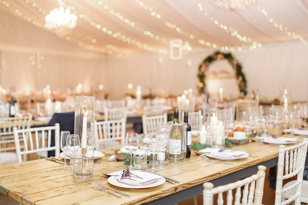 The wedding tablescape was done with greenery, candles and metallic touches for more elegance
