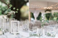 09 The wedding tablescapes were done with candles and greenery garlands plus centerpieces