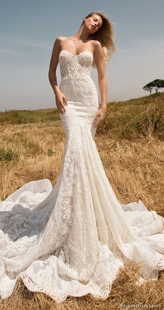 a strapless mermaid lace wedding dress with a sweetheart neckline and a train
