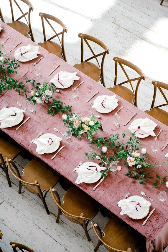 The tables were decorated with dusty pink velvet, chic floral centerpieces and candles