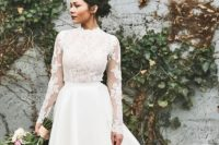 10 a glam bridal look with a lace applique wedding top with long sleeves and a high low layered skirt with a train plus printed shoes
