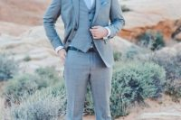 10 a grey three-piece wedding suit with a white shirt and a light blue tie is great for a spring wedding