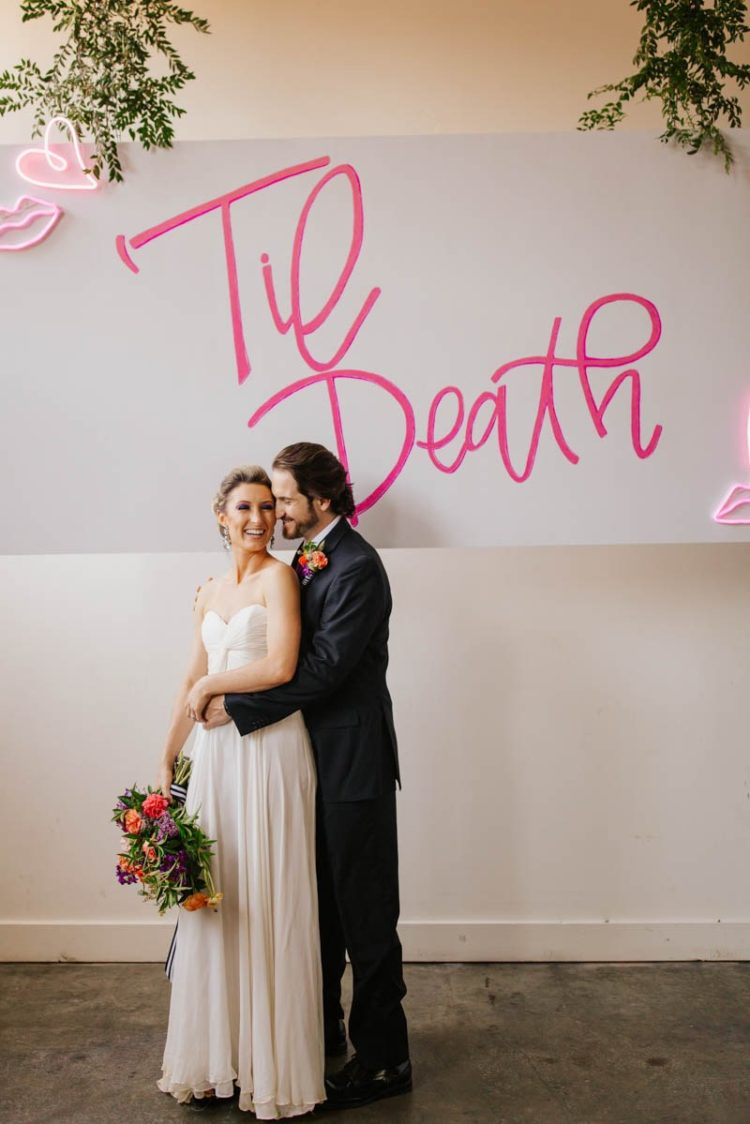 A large neon sign in pink was a great idea for a wedding backdrop