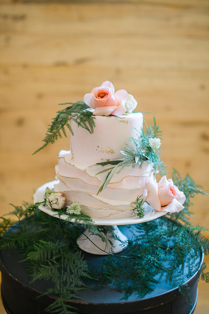 The wedding cake was a blush one with ruffles, gold edges and gold leaf plus blooms and greenery