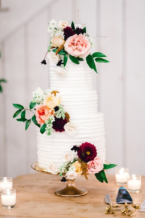 The wedding cake was a buttercream one topped with bold blooms for decor