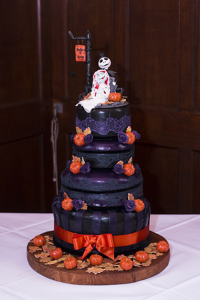 The wedding cake was done in black and purple, with orange accents and cool toppers