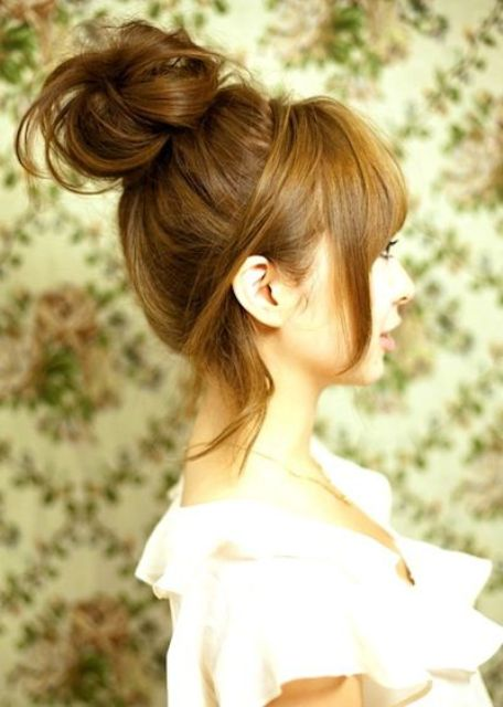 a messy top knot with some locks down and a fringe is a great boho chic idea