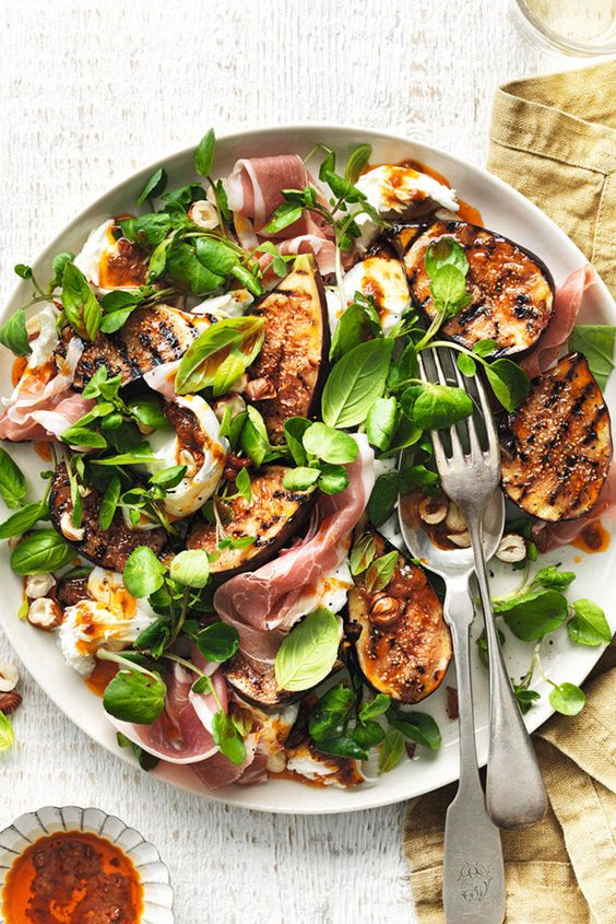 a fig, cheese, nuts, herbs and bacon salad is a hearty starter for a winter wedding