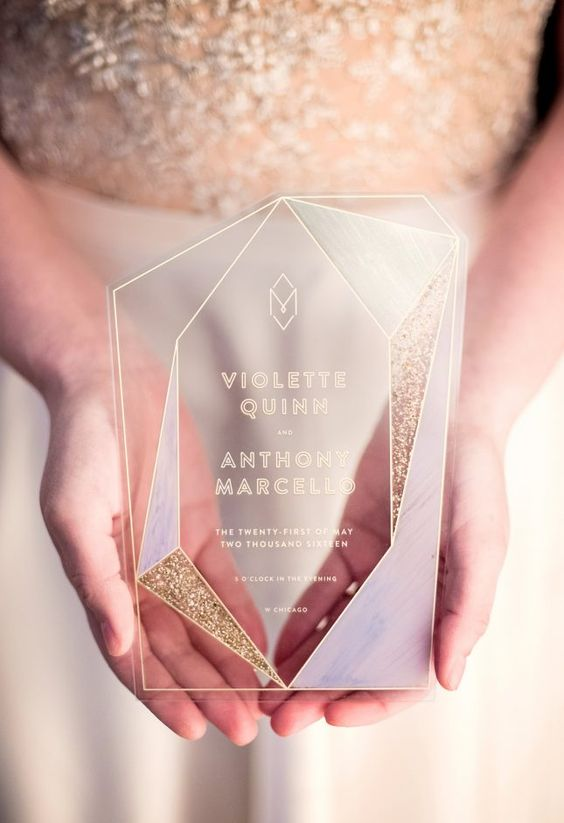 a glam acrylic invitation with gold glitter and a geometric shape