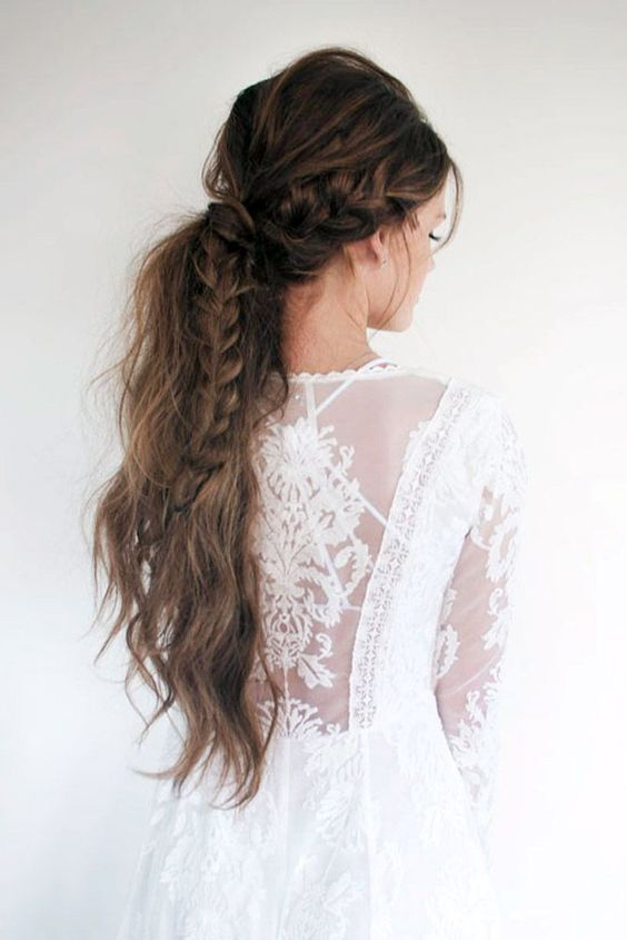 a long textural ponytail with a large braid and a bump looks truly boho chic