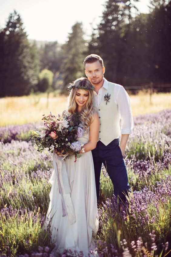 a relaxed lavender wedding dress and a matching groom's look with a waistcoat and navy pants