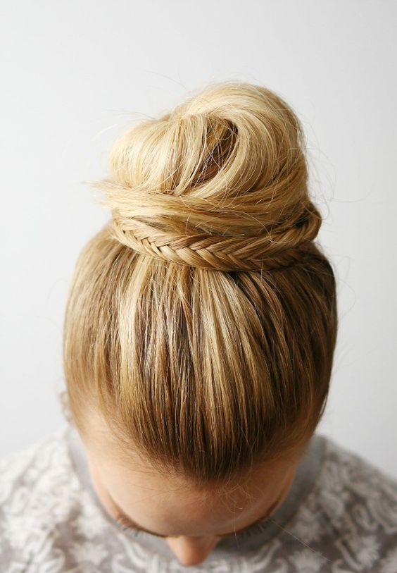 a sleek top knot decorated with a fishtail braid is an edgy and cool idea to rock