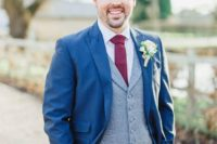 13 a bold blue suit, a grey waistcoat and a burgundy wide tie for a bright outfit