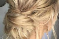 13 a messy low chignon hairstyle with lots of hair down for ane ffortlessly chic look