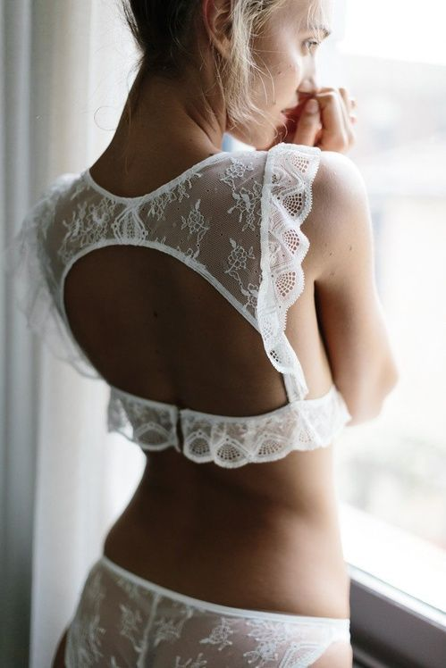 a sexy boho-inspired white lace lingerie set with a high neckline bra with a cutout on the back, ruffles and pantis