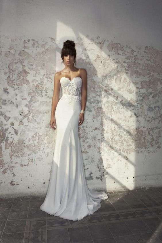 a chic strapless mermaid wedding dress with a sweetheart lace bodice and a plain skirt