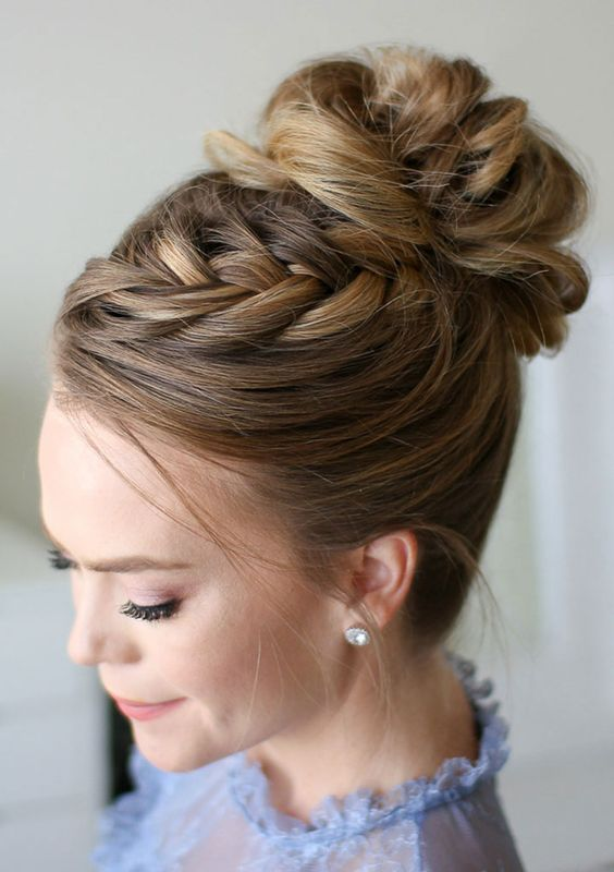 a wavy top knot with a braid on top is ideal to spruce up a traditional bun