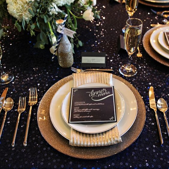 a black sequin tablecloth plus touches og gold glitter is what you need for a starry night wedding