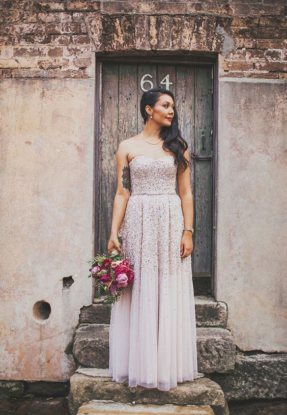 a blush strapless wedding gown with silver sparkles all over the bodice and partly on the skirt for shining bright