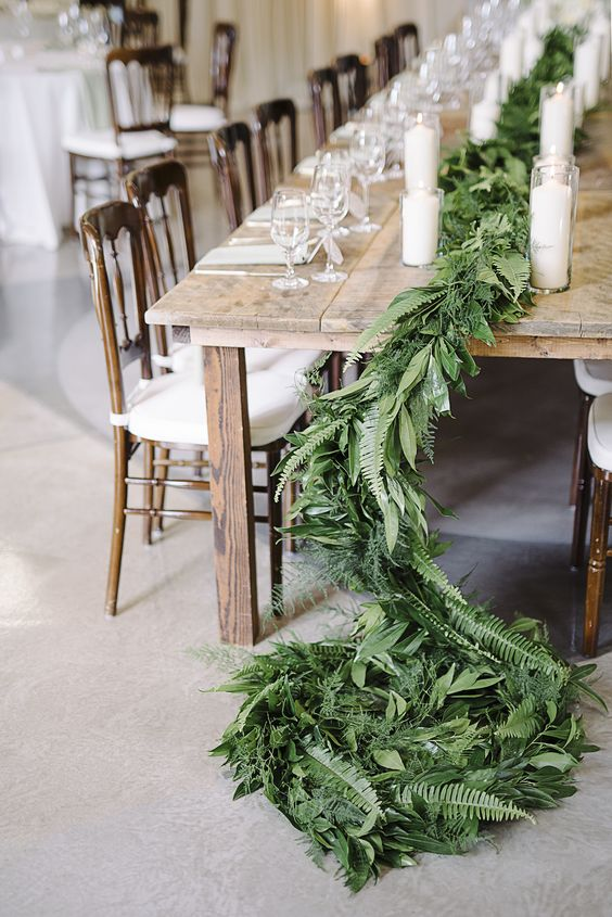 a simple leafy table runner with ferns for a rustic or natural table setting will bring texture