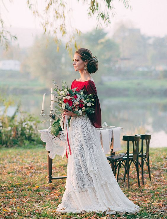 a chic bridal spearate with a white lace A-line maxi skirt, a burgundy top with wide sleeves plus statement earrings