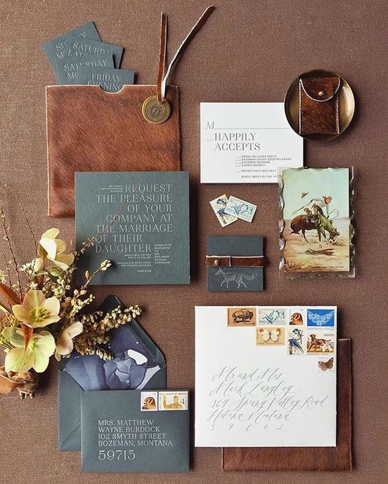 a chic leather and slate grey wedding invitation suite is a trendy idea