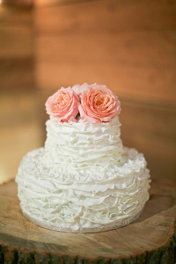a very sweet ruffle wedding cake topped with pink roses is great for a vintage wedding