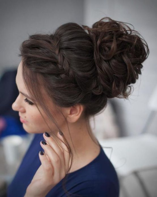 a wavy and curly top knot and a bump spruced up with a braid and some locks down is a wow option