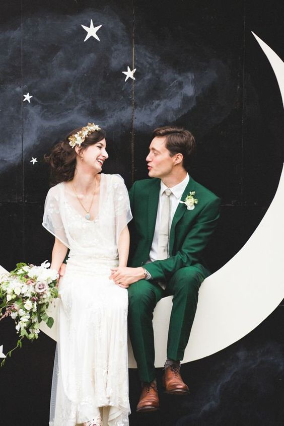 vintage looks with an emerald wedding suit plus a creamy tie and an art deco wedding gown