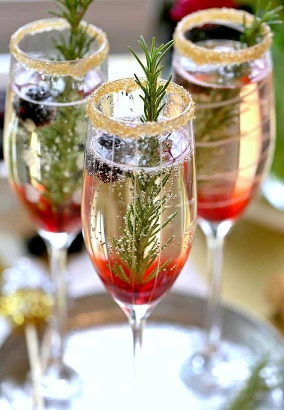 winter siganture cocktails with an ombre effect, thyme in glasses with a glitter edge