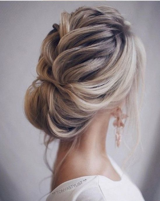 a beautiful loose braid into a bun with some locks down and much volume is very elegant
