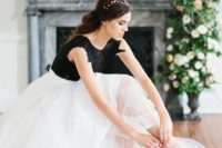 17 a white full skirt and a black lace applique bodysuit for a bold and contrasting look at the wedding