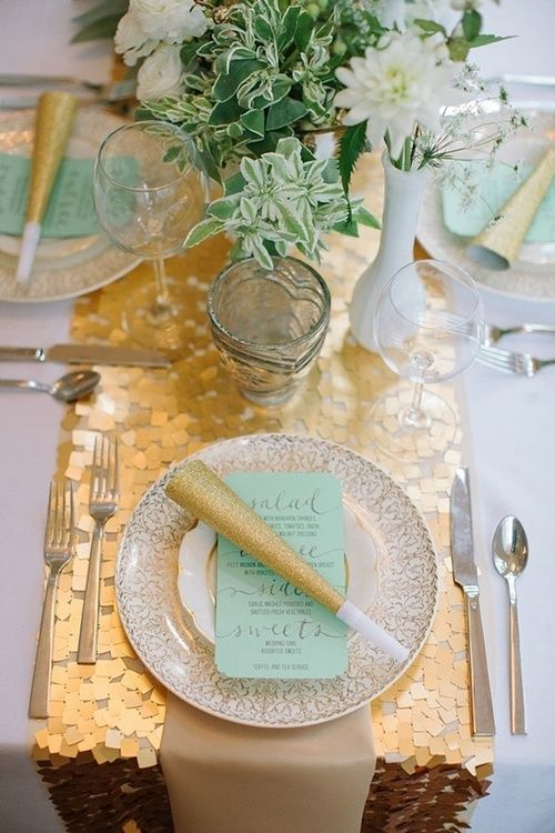 a gold chunky sequin table runner is amazing to spruce up a wedding tablescape in white and aqua