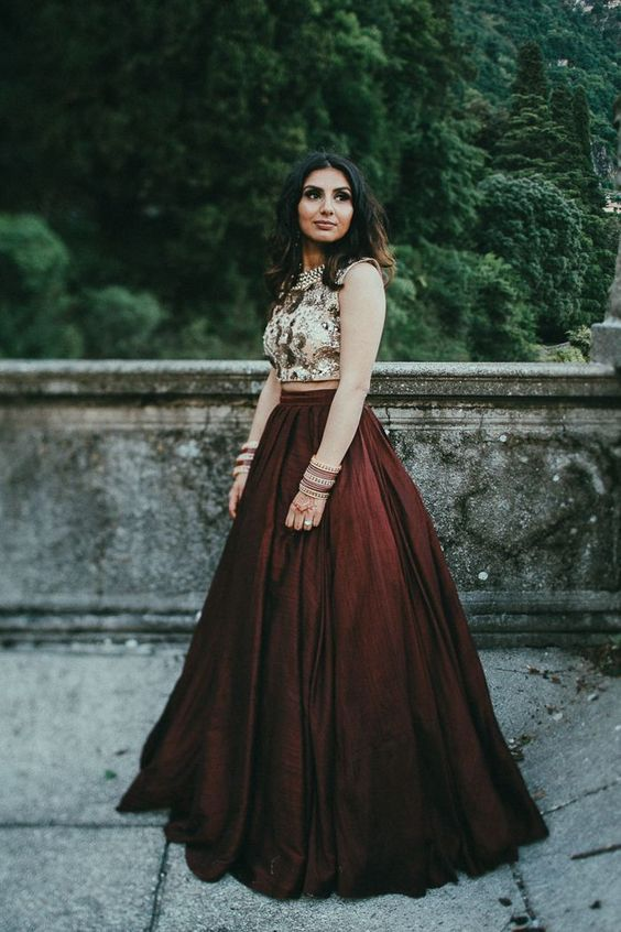 a gorgeous wedding separate with an embellished crop top and a deep burgundy A-line skirt