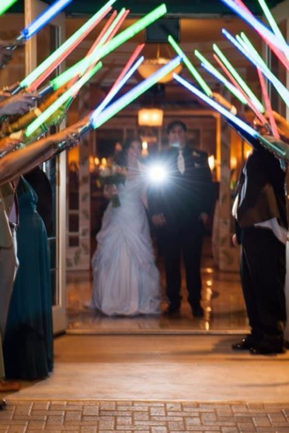 a light saber exit is a great idea for a Star Wars wedding or to add a geeky touch to your ceremony