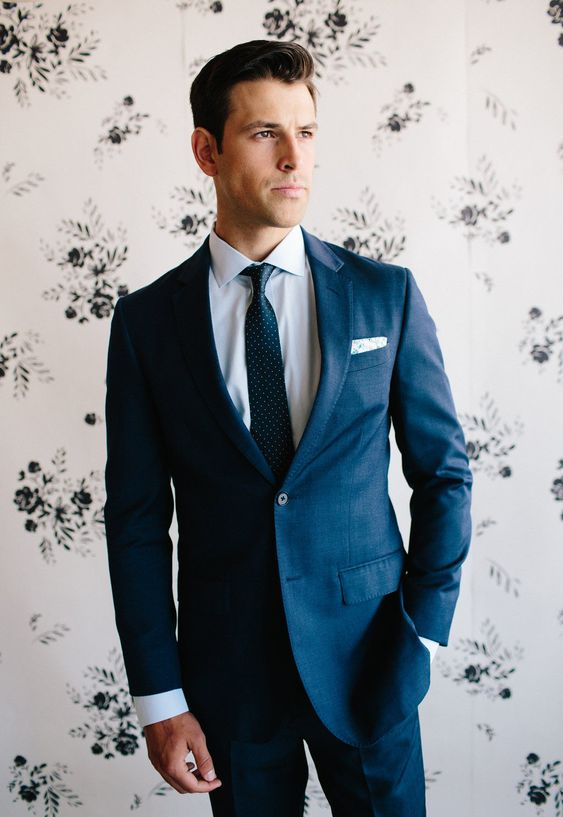 a perfectly tailored blue suit with a polka dot tie is what you need for a flawless look