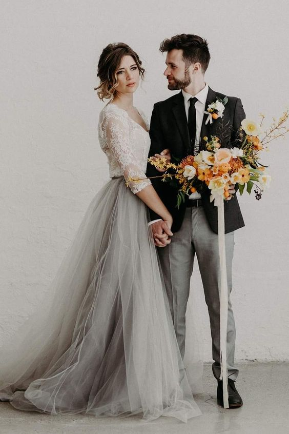 a white lace top with long sleeves and a grey tulle skirt is a chic and gentle idea for a bride