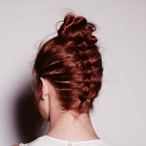 an upside down French braid with a top knot is a creative and whimsy option for top knot fans
