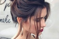 19 a large  top bun and some locks down is a striking idea if you have long and thick hair