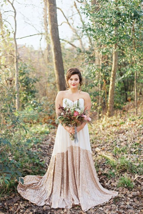 a modern glam strapless wedding gown with a plain top and a partly gold sequin skirt for a fall wedding