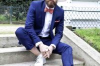 20 a bright blue wedding suit, no socks, white sneakers and a coral printed bow tie