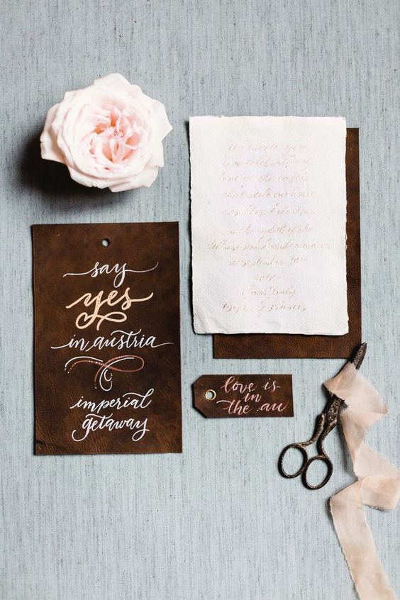 elegant leather masculine wedding invitation suite with calligraphy and neutrals