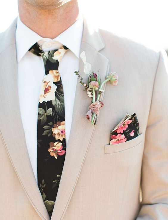 stand out with a floral tie and a handkerchief for a trendy touch in your look
