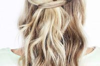 21 a half updo with a braided halo and waves down is a romantic and trendy option