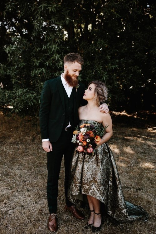 a non-traditional strapless wedding dress with a moody print and a high low skirt for a moody bride