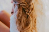 22 a half updo with a loose braid and waves down is a great romantic idea for a wedding guest