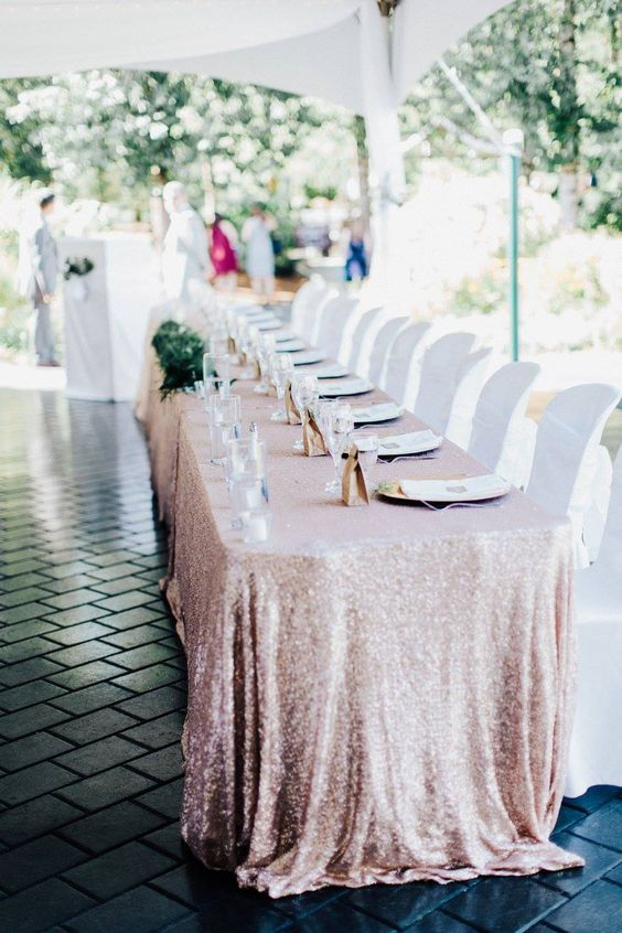 a pink sequin tablecloth is ideal for a modern glam wedding or to add a bit of glitter to your venue